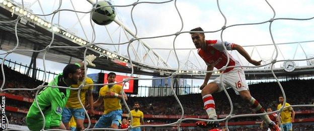 Arsenal's Aaron Ramsey scores