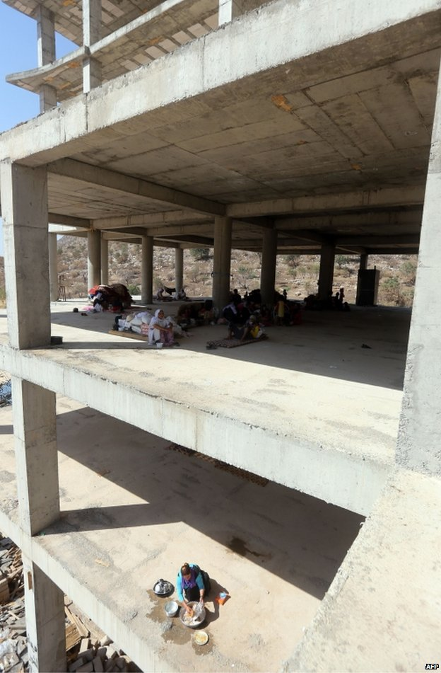 Yazidi refugees shelter in an unfinished building in Dohuk, northern Iraq, 16 August