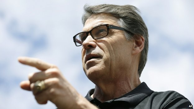 Texas Governor Rick Perry speaks at the Des Moines Register's Political Soapbox at the Iowa State Fair, on 12 August 2014, in Des Moines, Iowa.