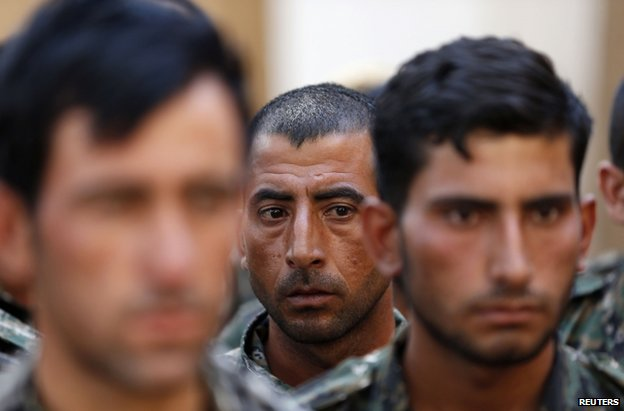 Iraqi Yazidi recruits under training with Kurdish forces in Qamishli, north-eastern Syria, 16 August