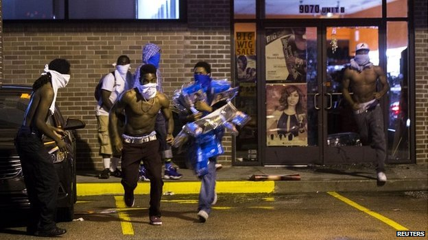 Looters run from a store in Ferguson, Missouri - 15 August 2014