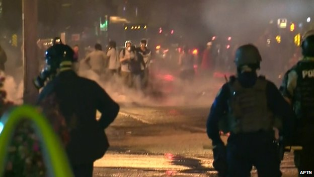 Police fire smoke bombs at protesters