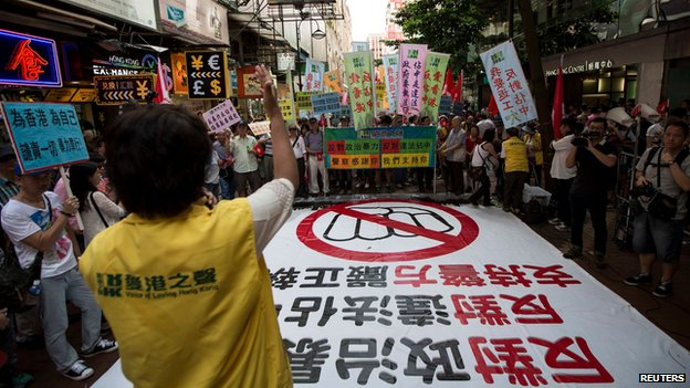 a pro-China group, attend a march to demonstrate against the so-called Occupy Central protest movement in Hong Kong July 13, 201