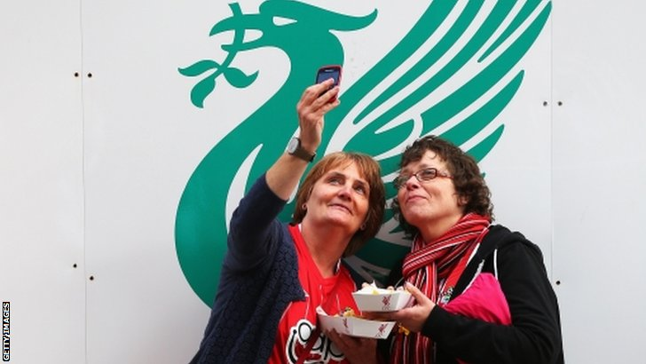 Southampton fans take a selfie outside the ground