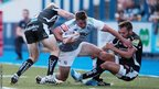 Dafydd Hewitt is tackled by Sam Hill and Phil Dollman as Cardiff Blues lose 17-24 to Exeter Chiefs in a pre-season friendly at Cardiff Arms Park.