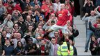 Wayne Rooney celebrates after bringing Manchester United level against Swansea City.