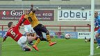Aaron O'Connor scores Newport County's second goal against Morecambe in League Twobut the home side came back to win 3-2.