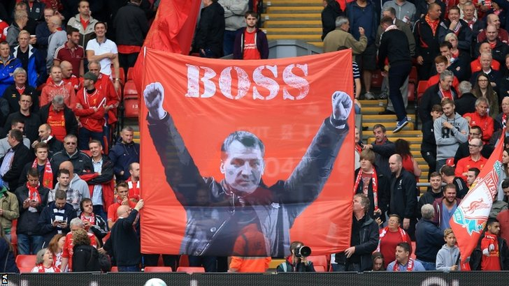"Liverpool fans display a banner of ""Boss"" manager Brendan Rodgers in the stands"