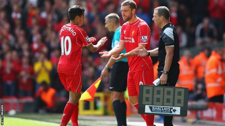 Rickie Lambert of Liverpool comes on as a substitute for Philippe Coutinho