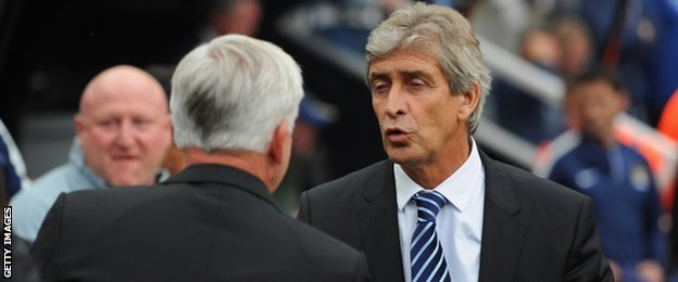 Newcastle manager Alan Pardew and Manchester City manager Manuel Pellegrini
