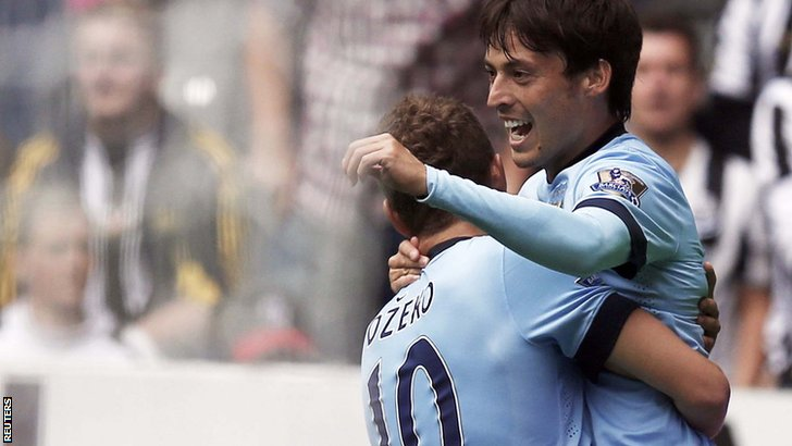 Manchester City's David Silva celebrates with teammate Edin Dzeko