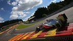 McLaren's Jenson Button drives through Eau Rouge
