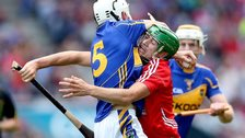 Tipperary's Brendan Maher is unable to get past Cork's Seamus Harnedy