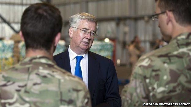 Handout image made available by the British Ministry of Defence (MOD) shows British Secretary of Defence Michael Fallon (C) meeting British Forces Personnel at RAF Akrotiri, Cyprus