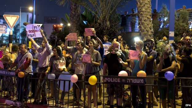 Left-wing supporters of the interfaith marriage gather with balloons and supportive placards including a heart outside a wedding hall in Rishon Lezion, Israel, on 17 August 2014