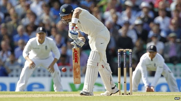 Virat Kohli is caught out by Alastair Cook for 20 runs during play on the third day of the fifth cricket Test match at The Oval in London on August 17, 2014