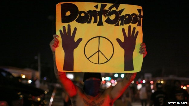 Protester in Ferguson holds up a 'Don't shoot' sign (17 August 2014)