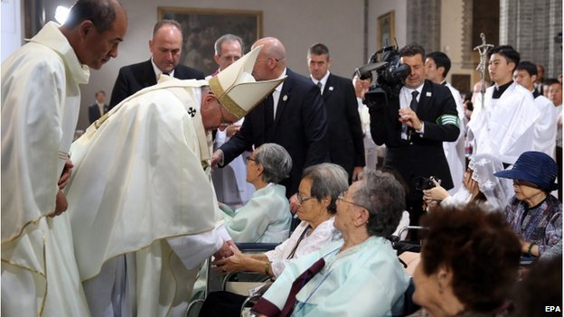 Pope Francis consoles South Korean victims of Japan's wartime sex slavery during a Mass for peace and reconciliation on the Korean Peninsula at Myeongdong Cathedral in downtown Seoul, South Korea, 18 August 2014