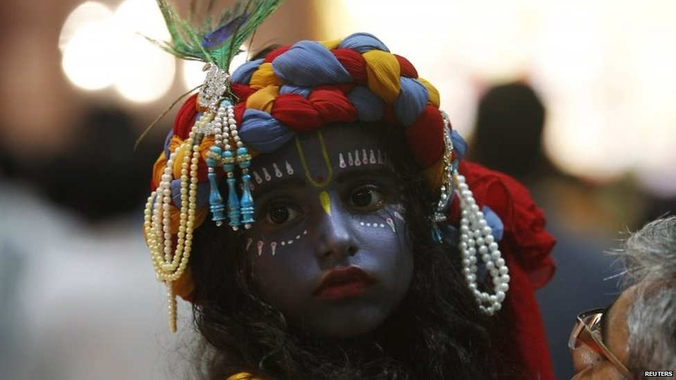 A child dressed as Hindu God Krishna attends a fancy dress competition at a temple during celebrations before the Janmashtami festival in the northern Indian city of Chandigarh August 16, 2014