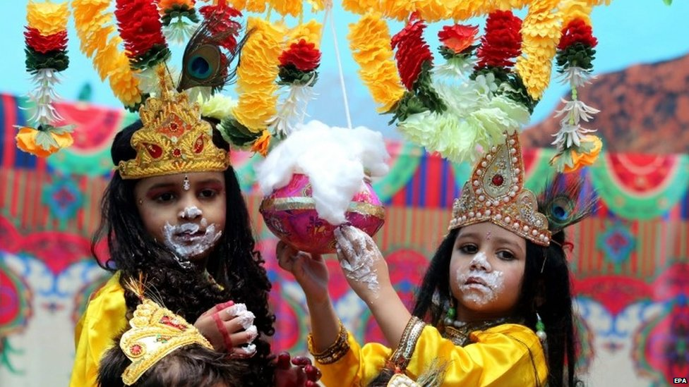 Children of a foundation school, dressed as Lord Krishna, take part in an event to mark the Janmashtami Festival in Bhopal, India, 16 August 2014.