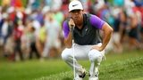 Rory McIlroy lines up a putt on the 14th green during the final round of the 96th PGA Championship at Valhalla Golf Club