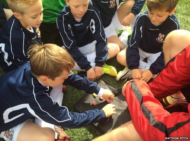 Lincoln City Football Club Youth Academy players with jelly babies