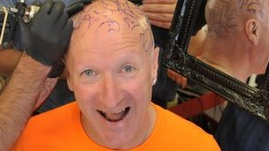 Captain Beany gets beans tattooed on his head
