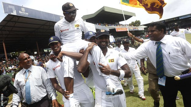 Sri Lanka's Mahela Jayawardene is carried off after his final Test