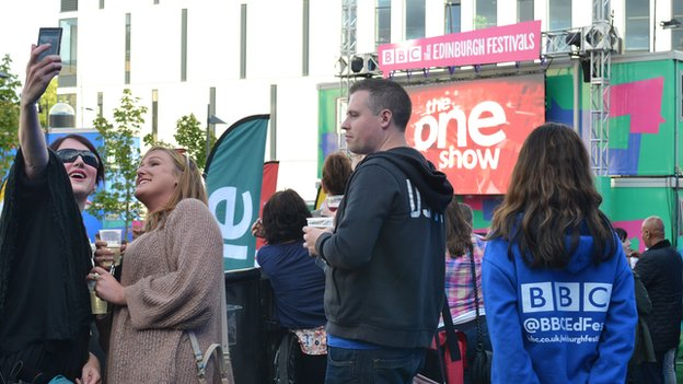 Members of the public take a selfie at the filming of the One Show