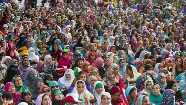 Supporters of Tahirul Qadri, a Pakistani-Canadian cleric, listen to his speech during a sit-in protest for the third day in Islamabad, Pakistan, 17 August 2014