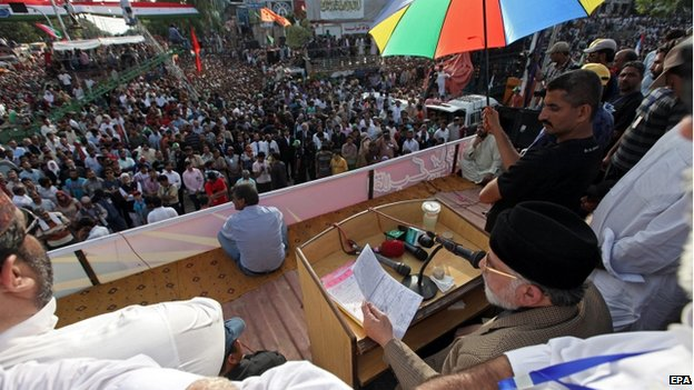 Tahirul Qadri, a Pakistani-Canadian cleric leaves after a speech to his supporters during a sit-in protest for the third day in Islamabad, Pakistan, 17 August 2014