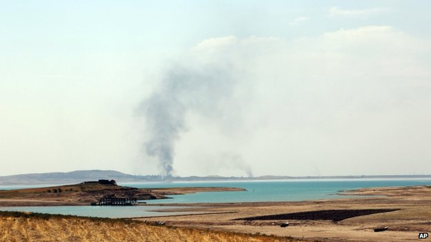 Smoke rises during air strikes on the dam - 18 August