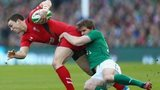 Wales win George North is tackled by Ireland's Andrew Trimble