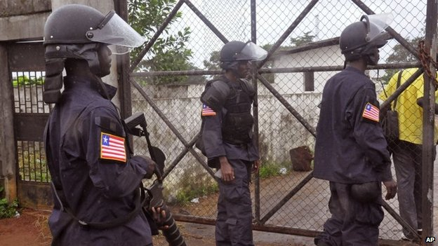 "Liberian Police dressed in riot gear deploy at a MSF, ""Doctors Without Borders"", Ebola treatment center as they provide security in the city of Monrovia, Liberia, Monday, Aug. 18, 2014."