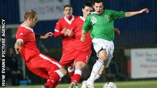 Steve Evans in action for Wales against Northern Ireland