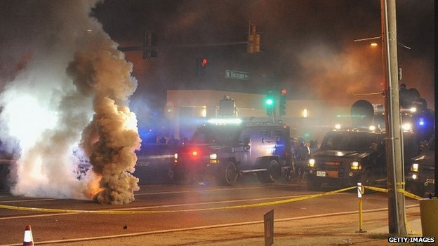 Law enforcement fires tear gas on protesters on West Florissant Road in Ferguson, Missouri 17 August 2014