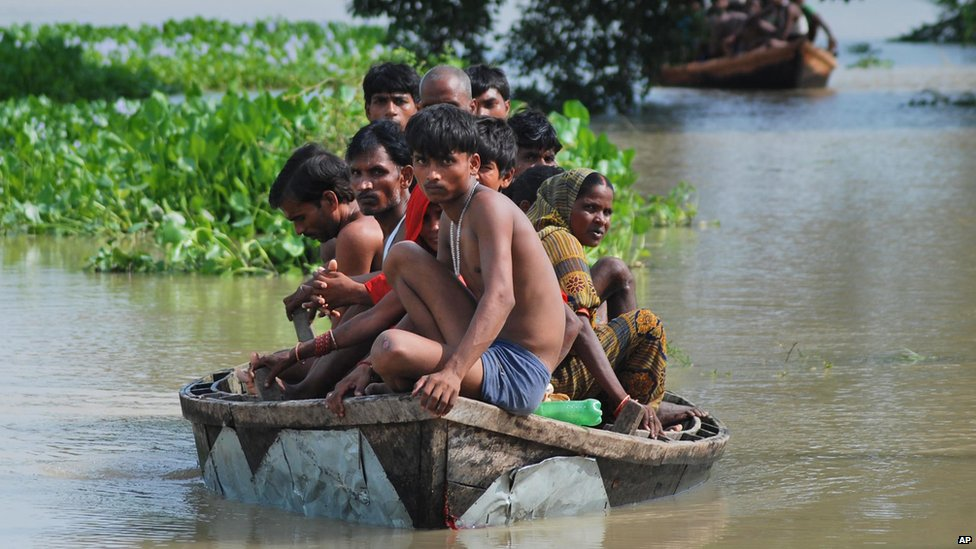 Villagers are marooned on a boat in flooded waters in India, 18 August 2014.
