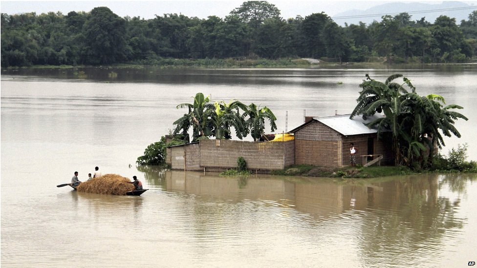 Villagers are stranded by their house in the middle of flood waters in India, 18 August 2014.