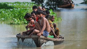 Villagers are marooned on a boat in flooded waters in India