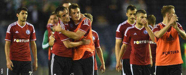 The Legia Warsaw players congratulate one another after the 2-0 win over Celtic at Murrayfield