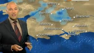 Dan Downs with weather map
