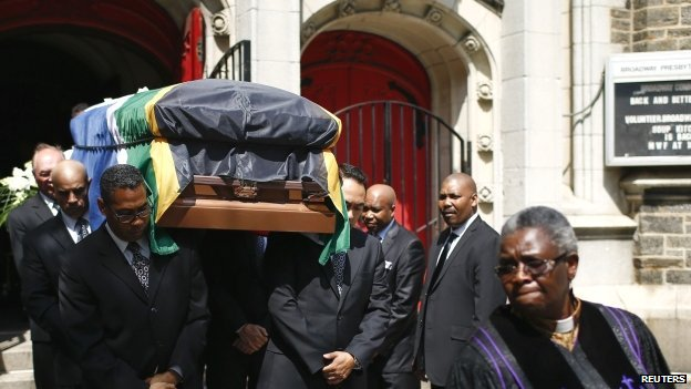 People carry the coffin of exhumed body of the South African journalist Nathaniel Nakasa after a public memorial service in the Broadway Presbyterian Church in New York, the US - 16 August  2014