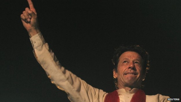 Imran Khan, cricketer-turned-opposition politician and chairman of the Pakistan Tehreek-e-Insaf (PTI) political party, gestures to his supporters during the Freedom March in Islamabad August 18, 2014.