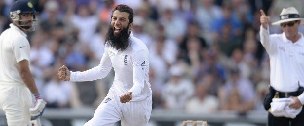 "England""s Moeen Ali (C) celebrates after dismissing India""s Cheteshwar Pujara (not pictured) during the fourth cricket test match at Old Trafford cricket ground in Manchester, England August 9, 2014."