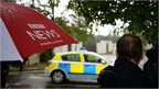 A police car passes the Charters Estate in Sunningdale, Berkshire, where Sir Cliff Richard has an apartment