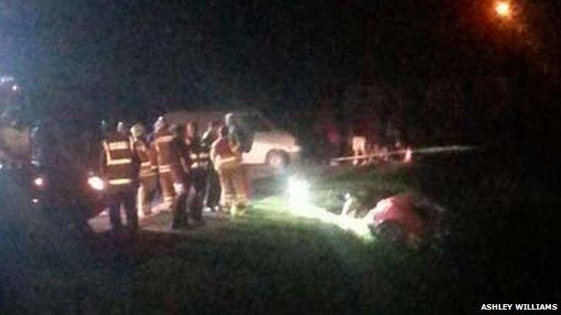 Emergency services surround car