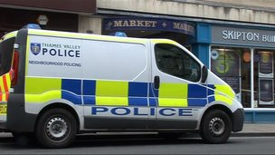 Police van outside covered market