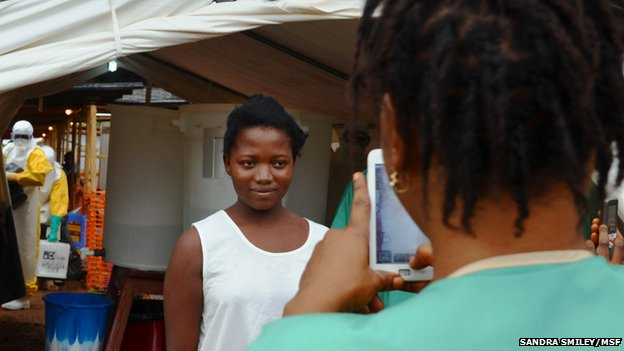 Woman leaves the MSF Ebola treatment centre