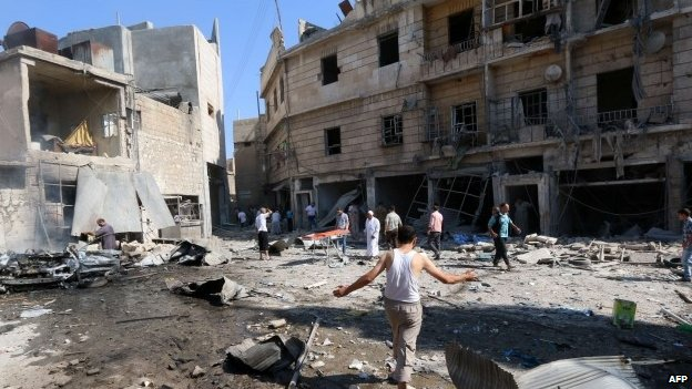 Syrians gather at the site of a reported barrel-bomb attack by government forces on August 13, 2014, in the rebel-held Qadi Askar neighbourhood in Aleppo. More than 170,000 people have been killed in Syria since the conflict began there in March 2011.
