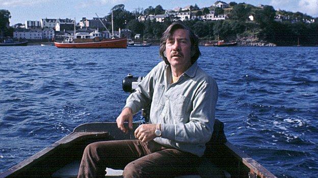 Derek Cooper on a boat